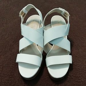White Cole Haan wedges.